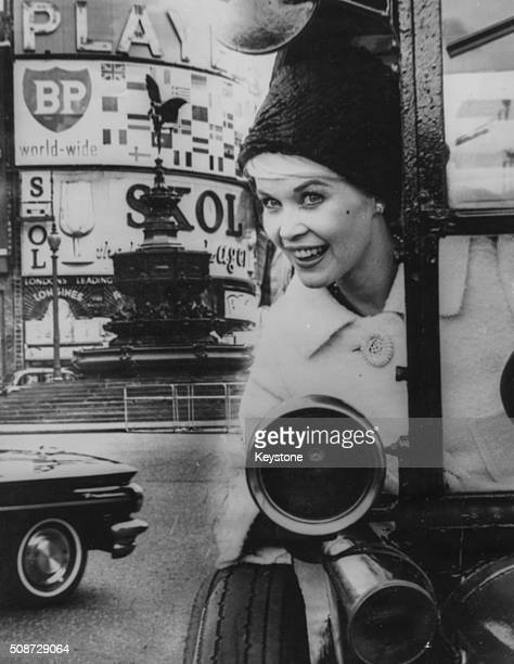 Portrait of actress Dorothy Provine star of the television show 'Roaring Twenties' at the wheel of a 1920's taxi in Piccadilly Circus prior to her...