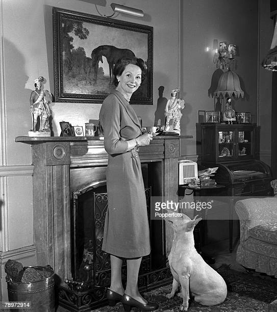 Portrait of Actress Elizabeth Allan at home with her pet dog 1952
