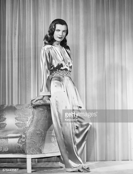 Portrait of actress Ella Raines wearing an ivory satin jumpsuit circa 1943