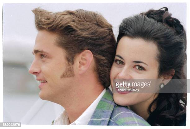 Portrait of actress Fiona Loewi and actor Jason Priestley close to each other and smiling on the set of the movie Love and Death on Long Island...