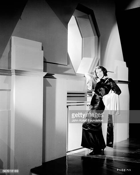 Portrait of actress Frances Dee posing on an asymmetrical set for Paramount Pictures 1931