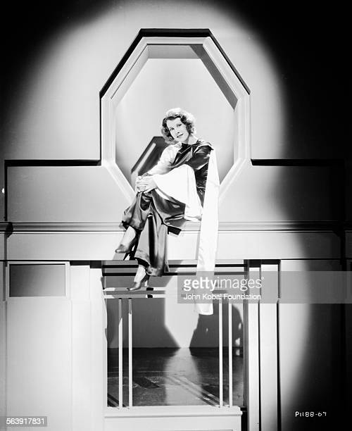 Portrait of actress Frances Dee sitting high up on an asymmetrical set for Paramount Pictures 1931