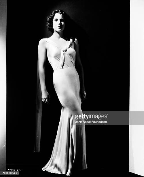 Portrait of actress Frances Dee wearing a slinky satin dress for Paramount Pictures 1932