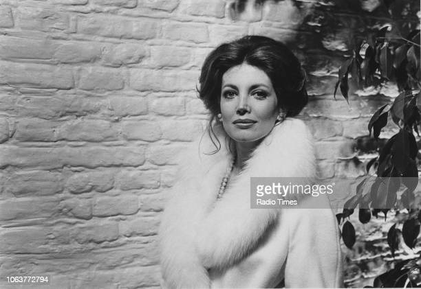 Portrait of actress Gayle Hunnicutt wearing a fur trimmed coat and standing in front of a brick wall March 1974