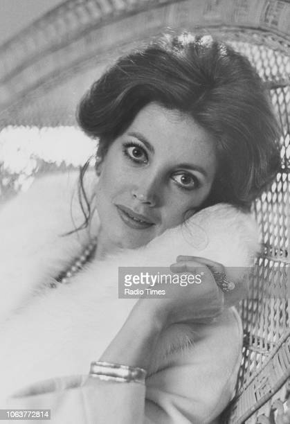 Portrait of actress Gayle Hunnicutt wearing a fur trimmed coat and sitting in a wicker chair March 1974 First printed in Radio Times issue 2630 page...