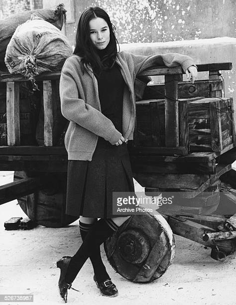 Portrait of actress Geraldine Chaplin standing next to a wagon as she appears in the film 'Doctor Zhivago' 1965