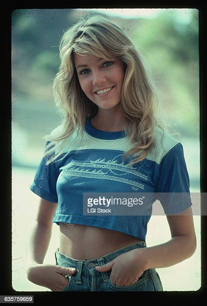 A portrait of actress Heather Locklear in jeans and cropped jersey Tshirt