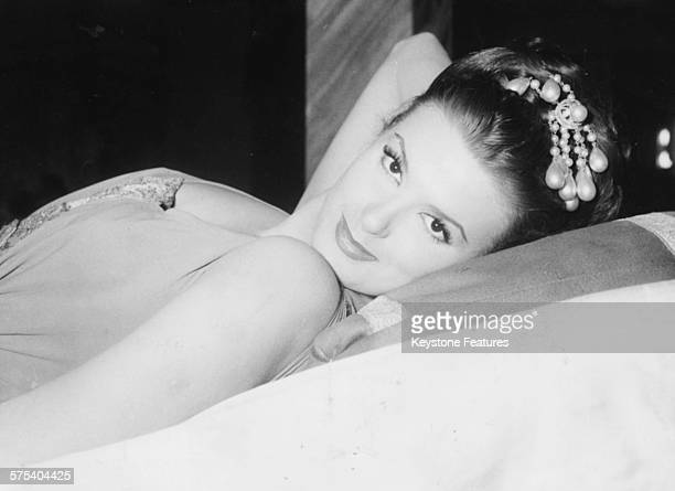 Portrait of actress Irene Tunc reclining back wearing an Ancient Greek costume, on the set of the film 'Aphrodite, Goddess of Love', 1958.