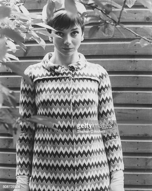 Portrait of actress Jacqueline Pearce star of the new film 'Don't Raise the Bridge Lower the Bridge' wearing a hat and geometric print dress circa...