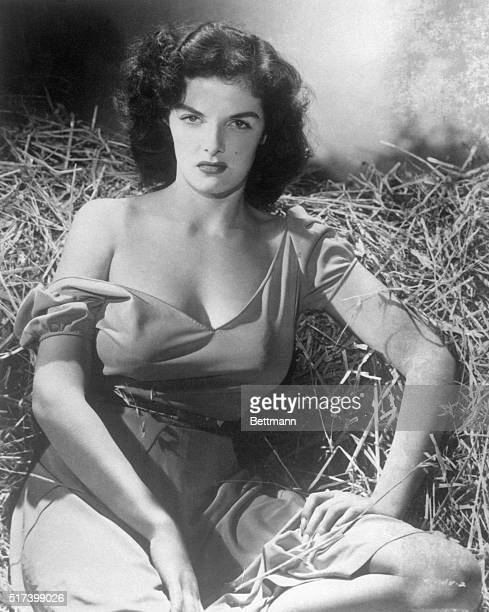 1/16/1947 Portrait of actress Jane Russell kneeling in a dress in the movie 'The Outlaw'
