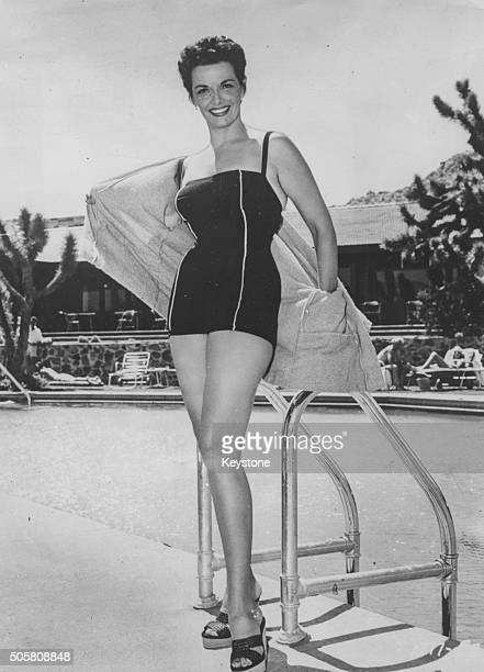 58faa898c371d Portrait of actress Jane Russell wearing a swimsuit at the side of a swimming  pool in
