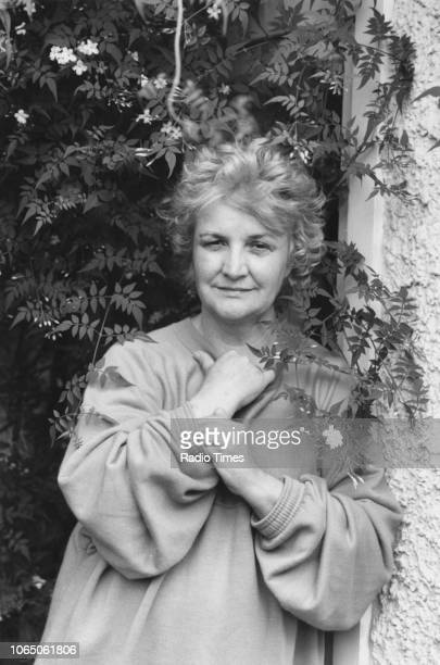 Portrait of actress Jean Boht in the garden of her home photographed for Radio Times in connection with the television drama 'Screenplay Eskimos Do...