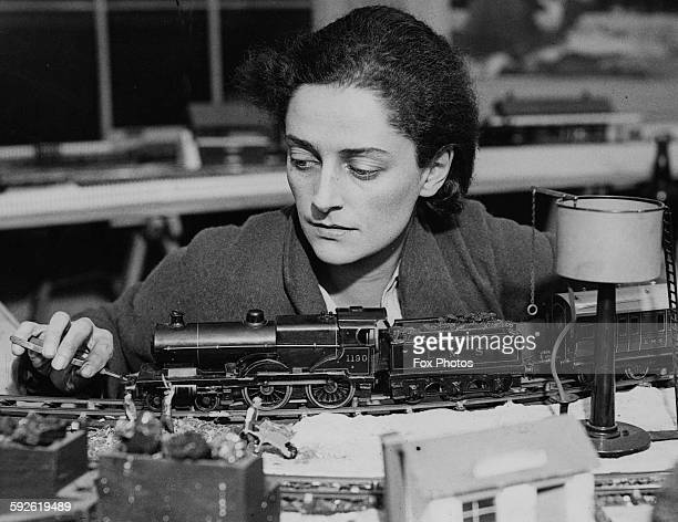 Portrait of actress Jean Forbes Robertson tinkering with a model train set printed following the announcement that she will play the role of 'Peter...