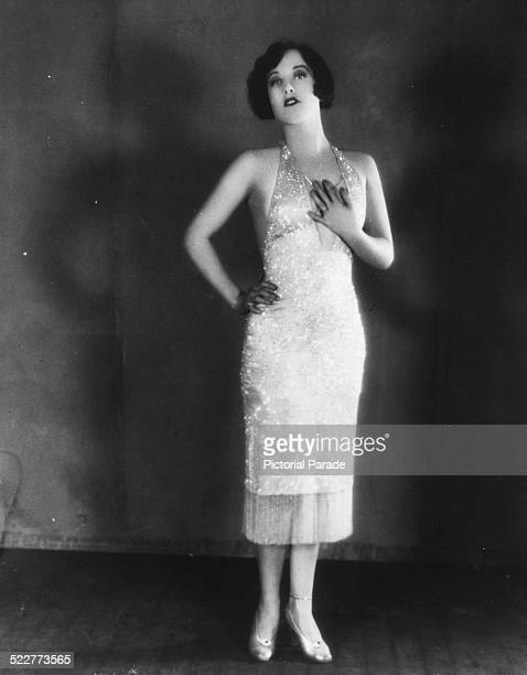 Portrait of actress Joan Crawford wearing a flapper dress as she appears in the movie 'The Taxi Dancer' 1927