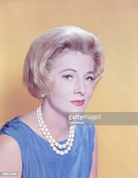 Portrait of actress Joan Fontaine wearing a pearl necklace ca1960s