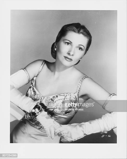 Portrait of actress Joan Fontaine wearing an evening gown and long gloves circa 1945