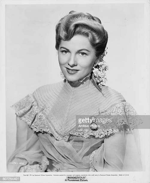 Portrait of actress Joan Fontaine wearing period dress as she appears in the movie 'Darling How Could You' 1951