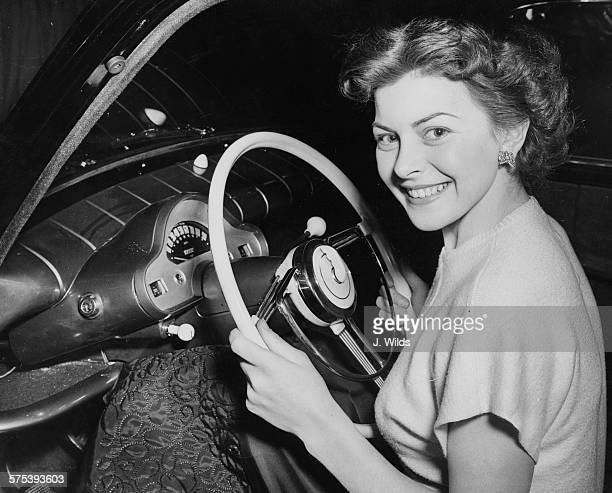 Portrait of actress Joan Rice at the wheel of the new Ford convertible 'Zephyr', at the Earl's Court Motor Show, London, October 17th 1951.
