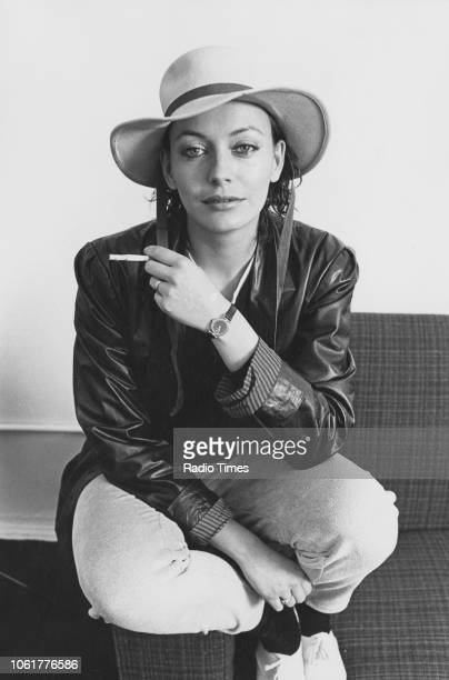 Portrait of actress Lesley Anne Down smoking a cigarette October 1980