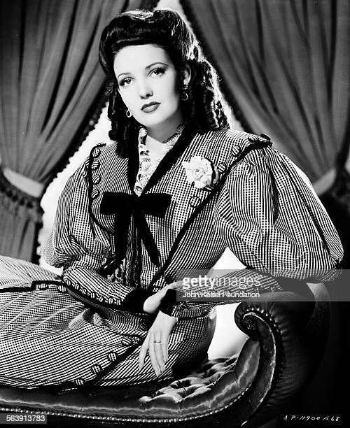 Portrait of actress Linda Darnell wearing an old fashioned dress with puff sleeves for 20th Century Fox circa 1950