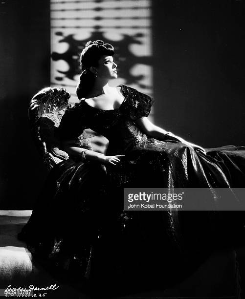 Portrait of actress Linda Darnell with her gown fanned out around her for 20th Century Fox circa 1950