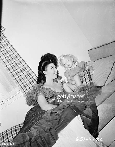 Portrait of actress Linda Darnell with her young daughter Charlotte for 20th Century Fox 1949