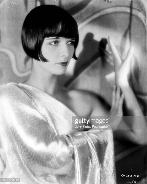 Portrait of actress Louise Brooks wearing a one shoulder dress for Paramount Pictures 1928