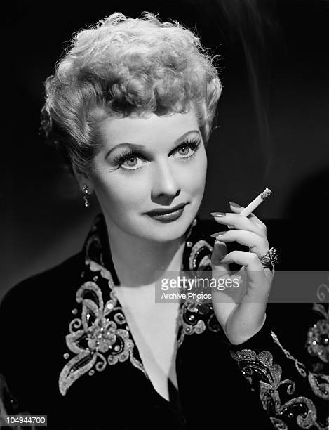 A portrait of actress Lucille Ball smoking a cigarette circa 1940