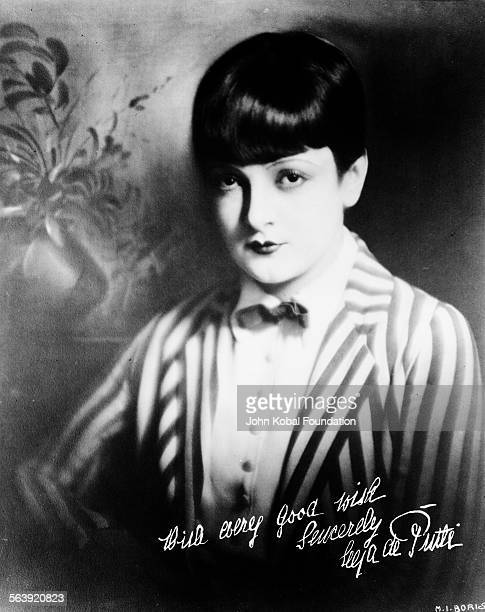 Portrait of actress Lya De Putti wearing a striped jacket and bowtie with her autograph 1925