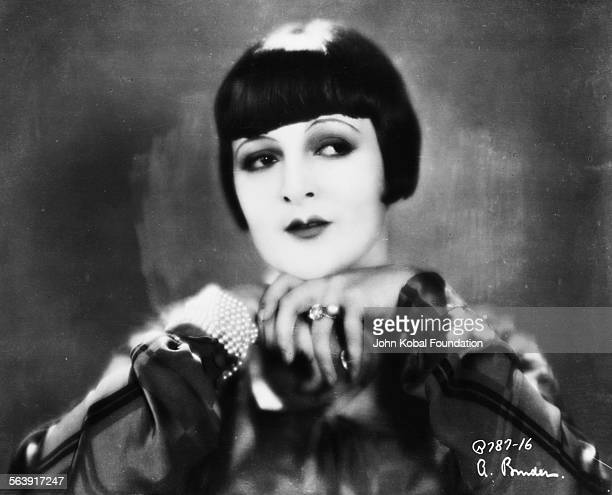 Portrait of actress Lya De Putti with her hands under her chin 1926