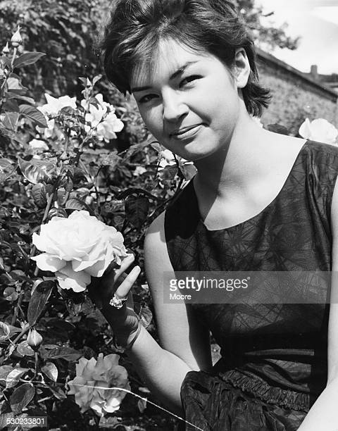 Portrait of actress Mandy Miller former child star posing in the garden of the BBC Television Centre filming 'Out of the Rain' London July 22nd 1961
