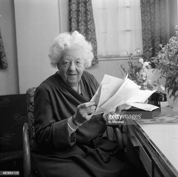 Portrait of actress Margaret Rutherford reading her fan letters at Elstree Studios London April 14th 1964
