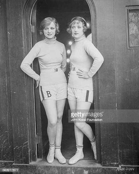 Portrait of actress Marion Davies posing in a doorway with an unknown actress for MGM Studios 1927