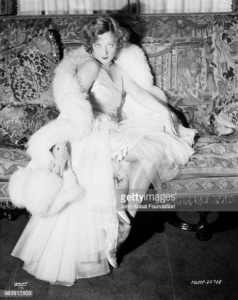 Portrait of actress Marion Davies wearing a fur stole and taffeta skirt for Apeda Studios 1929