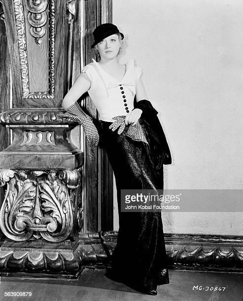 Portrait of actress Marion Davies wearing a hat and gingham gloves for MGM Studios April 12th 1933
