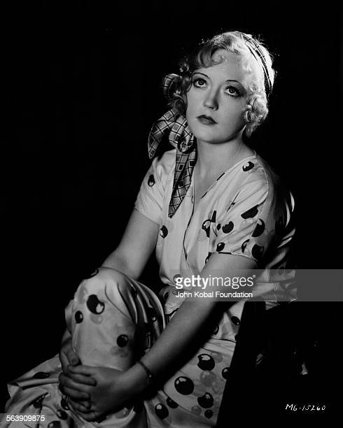 Portrait of actress Marion Davies wearing a head scarf for MGM Studios May 8th 1931