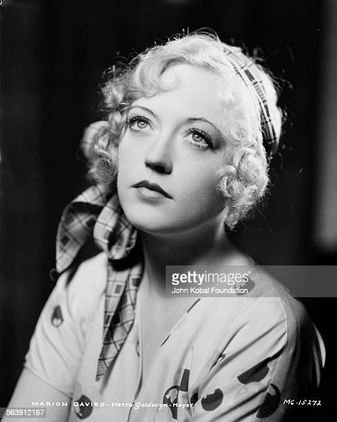 Portrait of actress Marion Davies wearing a headscarf for MGM Studios May 8th 1931