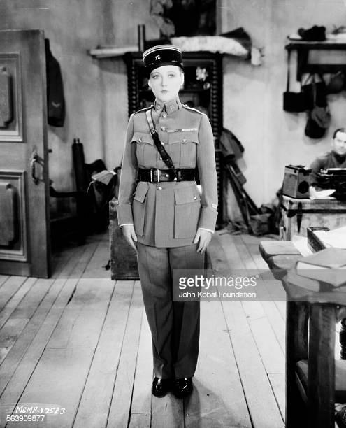 Portrait of actress Marion Davies wearing a men's army uniform for MGM Studios June 10th 1929