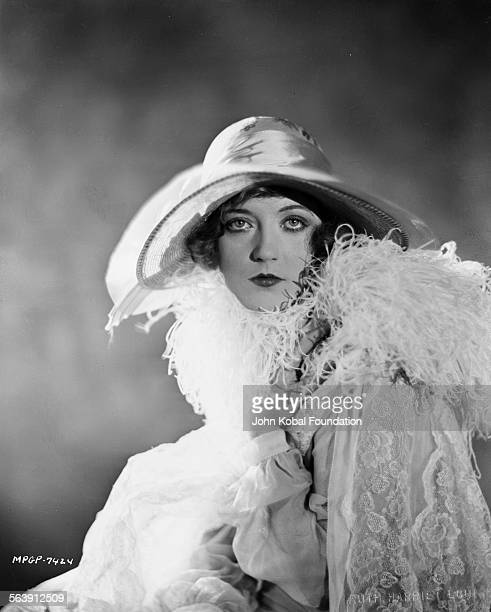 Portrait of actress Marion Davies wearing a widebrimmed hat and shawl for MGM Studios 1926