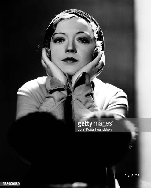 Portrait of actress Marion Davies with her hands under her chin for MGM Studios 1930