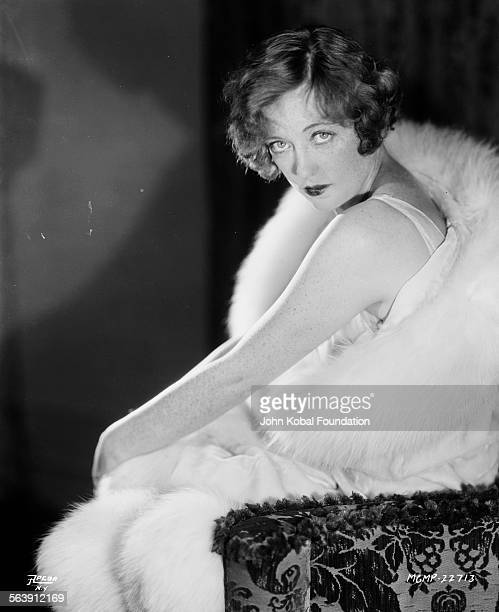 Portrait of actress Marion Davies wrapped in fur for Apeda Studios 1929