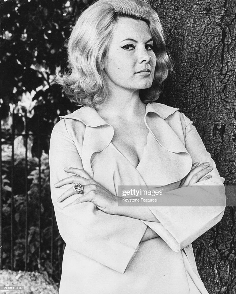 Portrait of actress Molly Peters, former Bond girl in the film 'Thunderball', standing in a London park prior to her appearance in the West End, England, circa 1965.