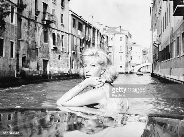 Portrait of actress Monica Vitti on a boat, attending the International Film Festival, Venice, September 11th 1962.