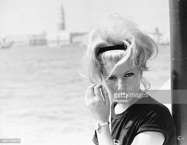 Portrait of actress Monica Vitti on a boat, attending the International Film Festival, Venice, September 1962.