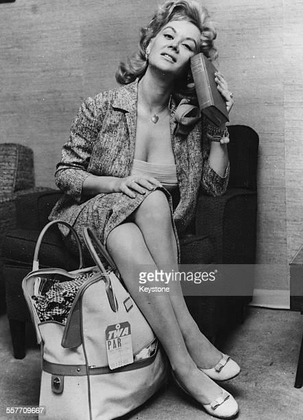 Portrait of actress Monique van Vooren at an airport circa 1955