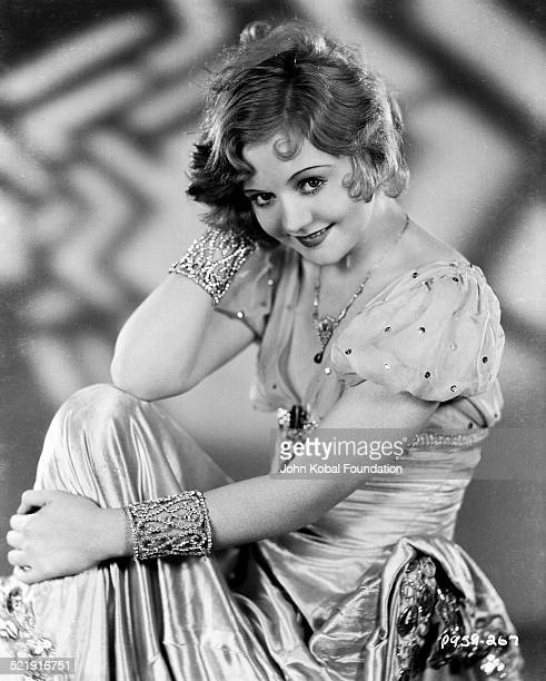 Portrait of actress Nancy Carroll wearing a beaded dress and jewelry for Paramount Pictures 1928