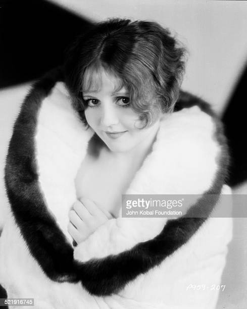 Portrait of actress Nancy Carroll wearing a fur coat for Paramount Pictures 1928