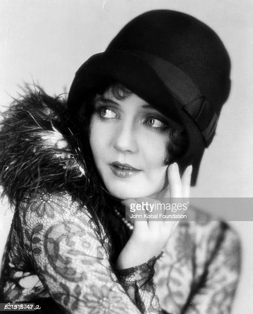 Portrait of actress Nancy Carroll wearing a hat as she appears in the movie 'The Shopworn Angel' for Paramount Pictures 1928