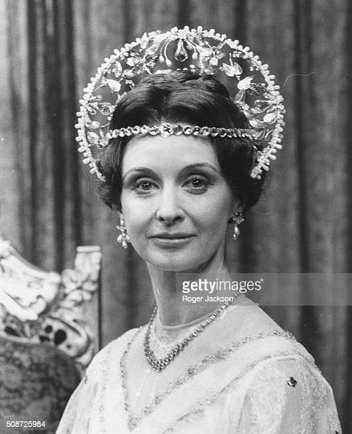Portrait of actress Nyree Dawn Porter wearing an ornate headdress in costume during rehearsals for the play 'Anastasia' at the Cambridge Theatre...