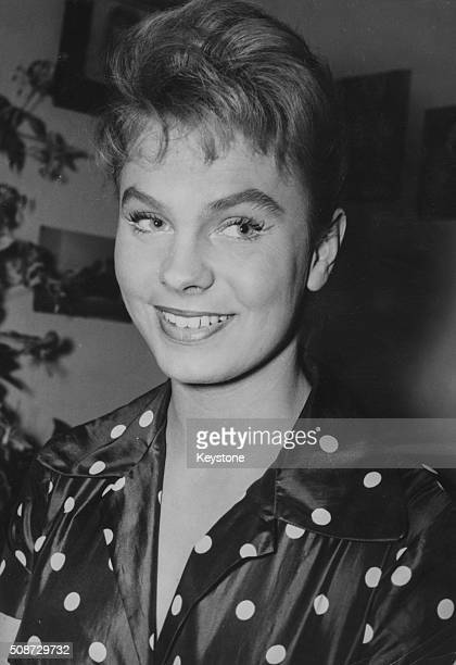 Portrait of actress Odile Rodin rumored fiance of diplomat Porfirio Ruburisa wearing a polka dot blouse in her dressing room October 13th 1956